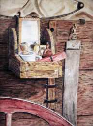 Painting of a shaving kit on an old chuck wagon.